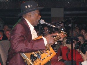 Bo Diddley in Prague (Lucerna Bar), 2005. picture by Stefan Reicheneder, used under permission under the GFDL, Cc-by-sa-3.0 licence. Source: http://en.wikipedia.org/wiki/File:Bo_Diddley_Prag_2005_02.jpg