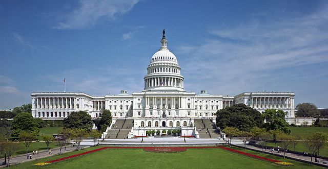 The western front of the United States Capitol. The Neoclassical style building is located in Washington, D.C., on top of Capitol Hill at the east end of the National Mall. The Capitol was designated a National Historic Landmark in 1960. By United_States_Capitol_-_west_front.jpg: Architect of the Capitol derivative work: O.J. (United_States_Capitol_-_west_front.jpg) [Public domain], via Wikimedia Commons. https://commons.wikimedia.org/wiki/File%3AUnited_States_Capitol_west_front_edit2.jpg